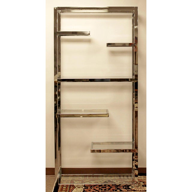 For your consideration is a magnificent, chrome etagere shelving unit, with six uneven shelves, by Milo Baughman, circa...