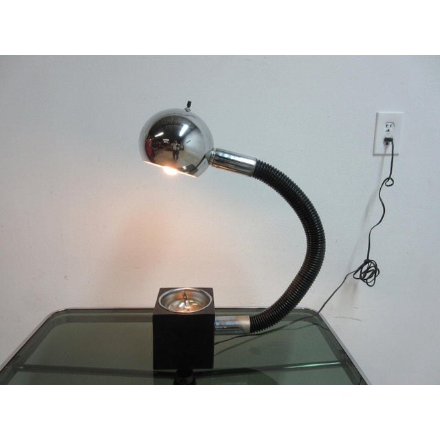 Up for consideration is this Mid-century orb eye table lamp. The neck is adjustable and the base doubles as an ash tray....