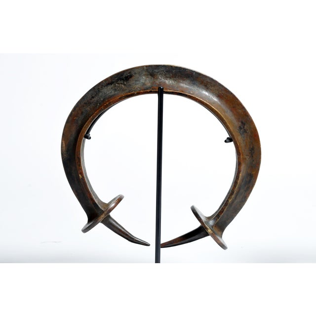 This Yoruba neck ring was cast from copper alloy using the lost wax method. The Yoruba are found principally in Nigeria...