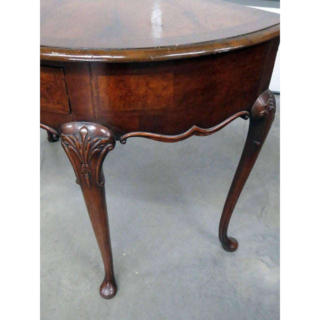 Queen Anne style burl walnut demilune console table with one drawer.