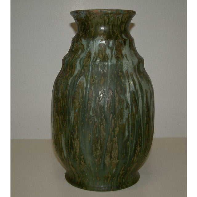 Luxembourg Circa 1930 An Art Deco form Villeroy & Boch vase with a very controlled matte and high glaze green drip finish....
