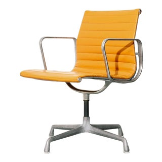 Vintage Eames Aluminum Group Chair in Orange For Sale