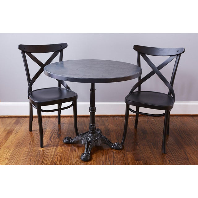 This fabulous table is made by Europe 2 You and modeled after vintage French Cafe Bistro tables. Enjoy a coffee or meal...
