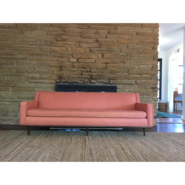 Super gorgeous salmon colored mid century sofa in excellent condition. This piece was purchased & reupholstered in LA a...