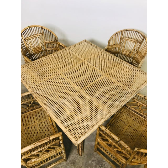 Presenting an extremely rare Brighton Pavilion dining set with an all-cane table top. The caning is in exquisite condition...