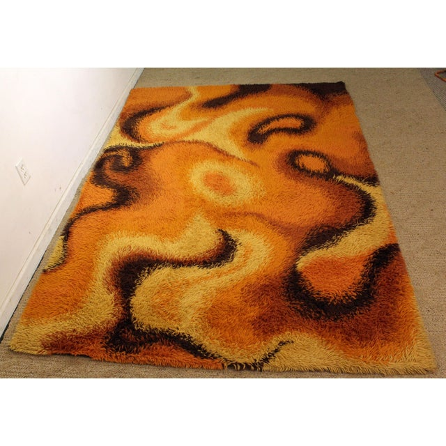 Offered is a Mid-Century Modern orange shag rug with a groovy print. The rug is in excellent condition (no stains or...