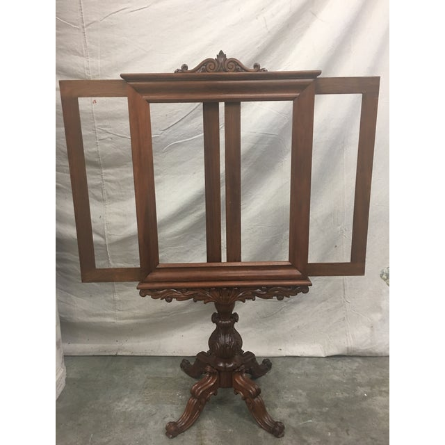 Beautiful English antique mahogany fireplace screen, featuring expandable panels, and a carved pedestal base. This lovely...