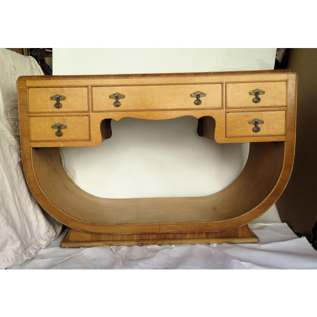 Rare 1930's French burl veneer, bowed wood, lady's Art Deco vanity. It has 5 drawers and the original brass hardware is...