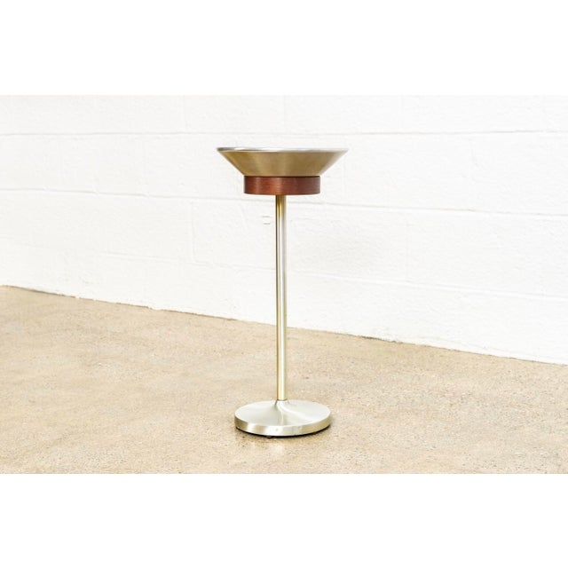 This unique vintage mid century ashtray floor stand is circa 1960. The classic mid century design features a brushed...