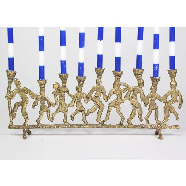 1950's Folk Art Dancing Figures Brass Menorah Candle Holder For Sale - Image 4 of 7