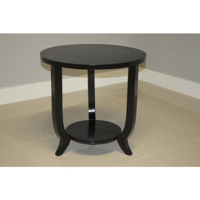 Beautiful French Art Deco period black ebonized side table or coffee table, circa 1940s. The table is ebonized with a...