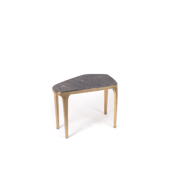 The Cosmos nesting coffee table medium is both Minimalist and dramatic. The top is inlaid in black shagreen, that is hand-...
