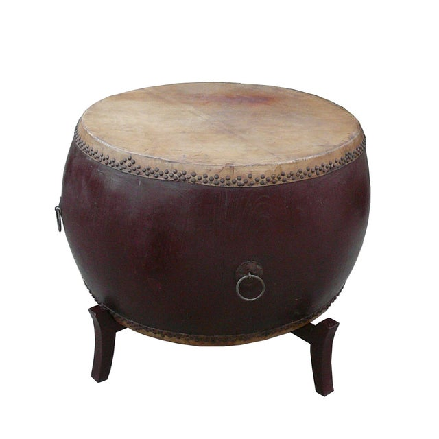 This is a traditional Chinese drum in rustic brown lacquer color. It is an old used piece, so the top is not in perfect...