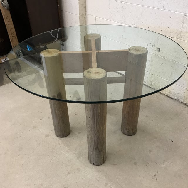 Very cool rustic log table. Not sure of wood type, but it is solid despite the obvious cracks in the photos. Glass is in...