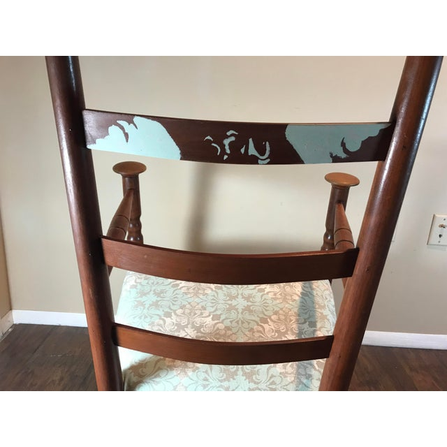 Completely reupholstered in a modern but soft design with reconditioned wood. The stencil on the third back slat was hand...