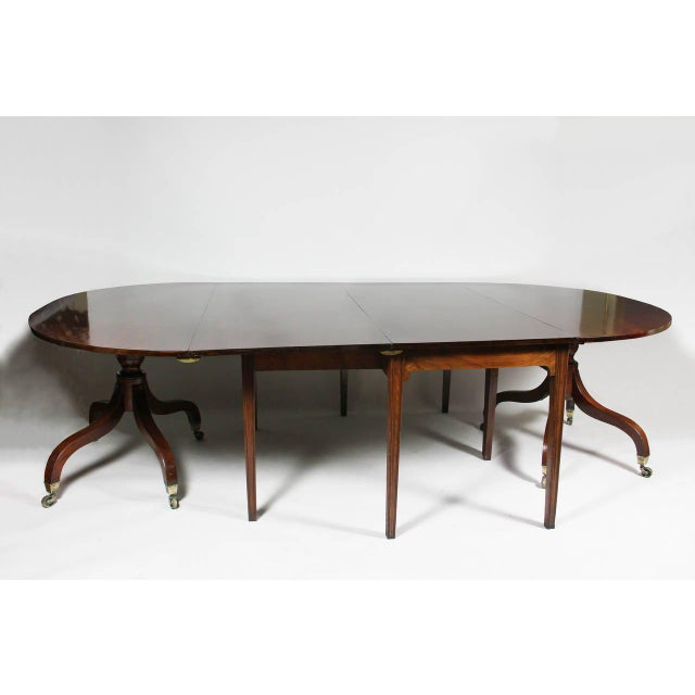 Beautifully figured top with two original leaves, the center section a table with four molded straight legs with optional...