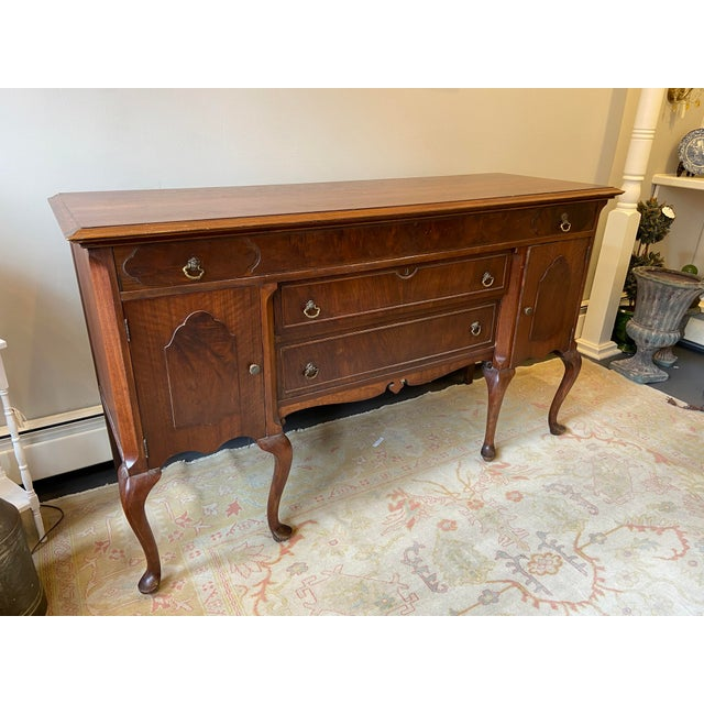 This is beautiful mahogany sideboard. It is Burled wood. The legs are french Queen Ann style legs. There is one long top...