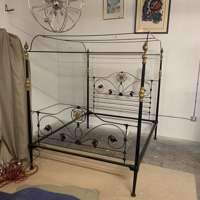 This is a superb original 19th Century antique cast iron four poster bedstead with original brass fittings and fine cast...