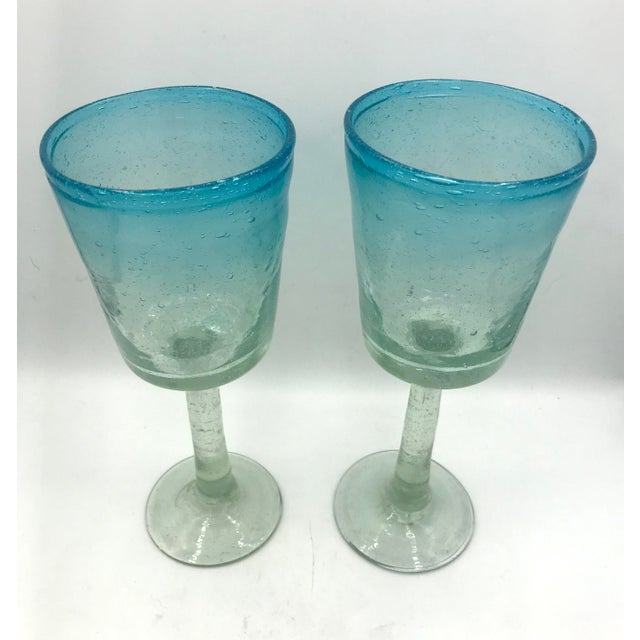 Hand blown tall wine glasses or goblets in a stunning Aqua ombre. The glass is filled with natural small bubbles and there...