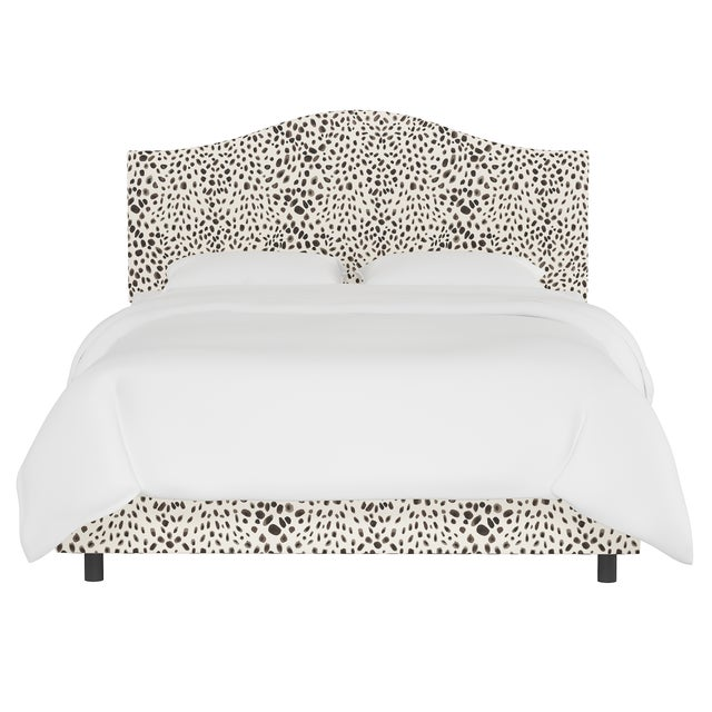 This fully upholstered bed has a unique headboard shape, allowing you to chart a course for a bedroom retreat that is at...