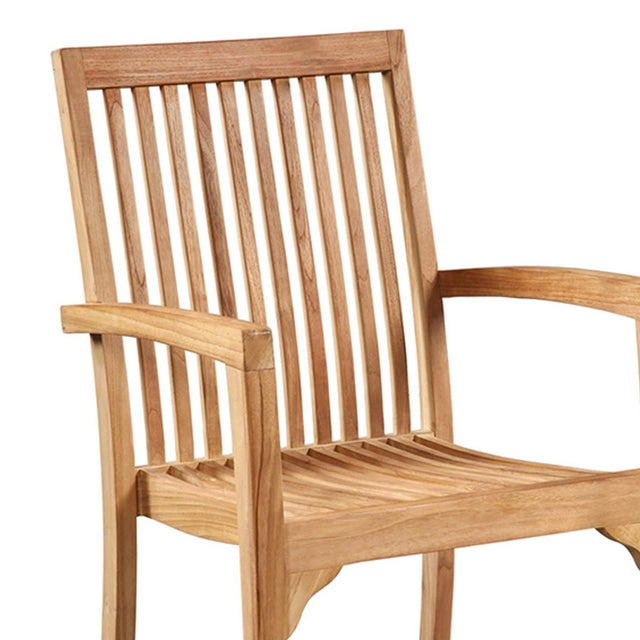 Teak dining chair. Premium solid teak construction. For indoor and outdoor use. Each chair has slight variations of color,...