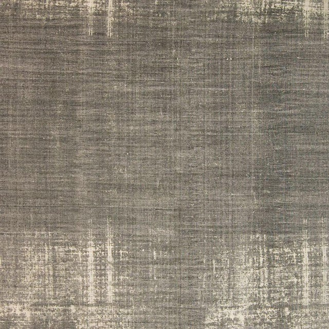 This is a cotton 'Dhurrie' rug. The piece features a grey distressed pattern.