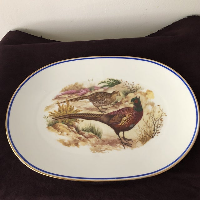 Fantastic Kubo porcelain vintage pheasant serving platter hand painted with a blue and gold gilded trim this vintage piece...