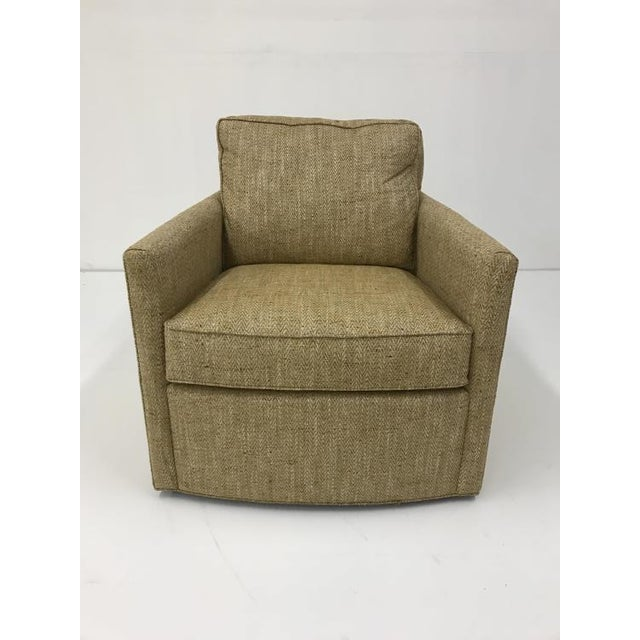 The Willis Swivel Chair is a first quality market sample that features a gold fabric.