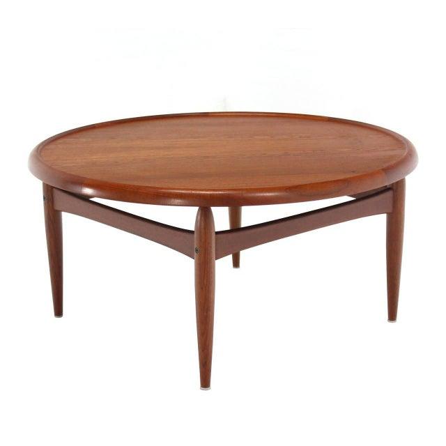 Reversible top Danish modern round coffee table.