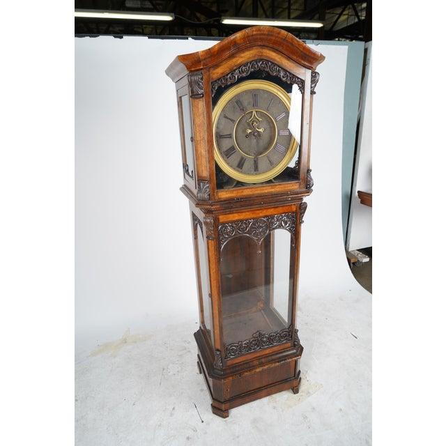 This listing is for an unusual tall case/grandfather clock. The clock is of Austrian origin and was built in a baroque...