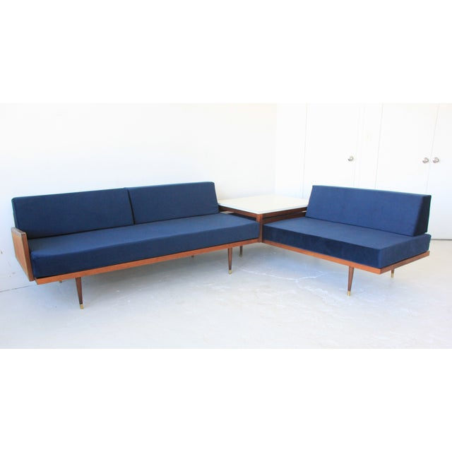 2 pieces - 1 long sofa with white table attached and 1 chaise lounge that fits underneath. The chaise lounge slides...