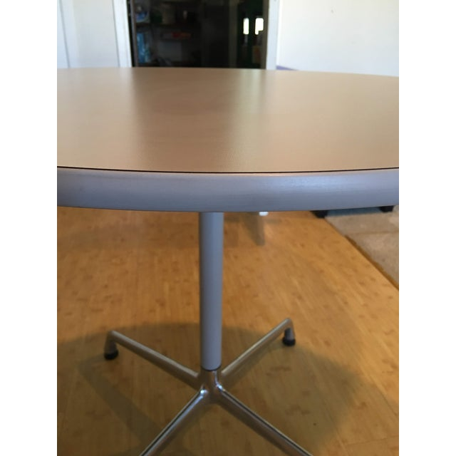 This table has a laminate top with vinyl edge and classic universal base used by the Eames. The surface, edge, and column...