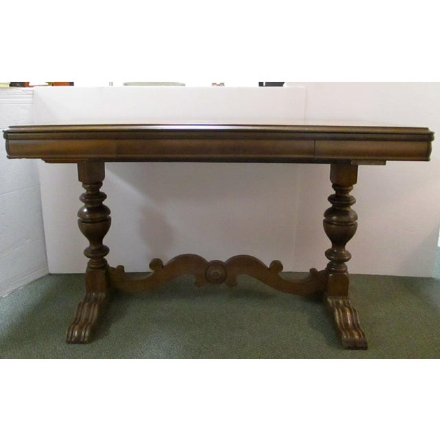 "Antique walnut carved library table that expands an additional 12"" by pulling out table in front and back."