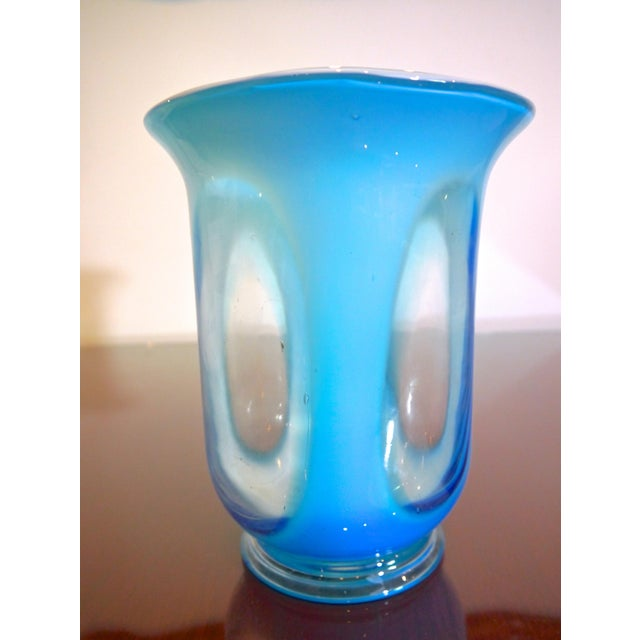 Hand blown 1950's Swedish blue and clear glass vase. A unique piece to add a pop of blue!