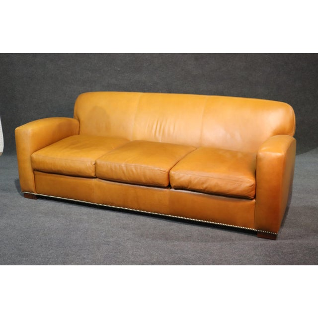 Ralph Lauren Art Deco style 3 seat sofa with distressed leather upholstery and nailhead trim.