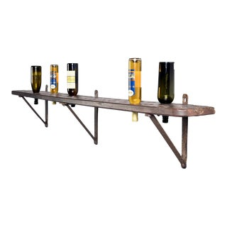 Early 20th Century Rustic French Wood and Iron Shelf-Style Wine Rack For Sale