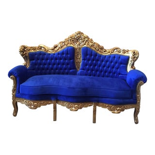 Blue Tufted Sofa and Gilded Frame Acanthus Details For Sale