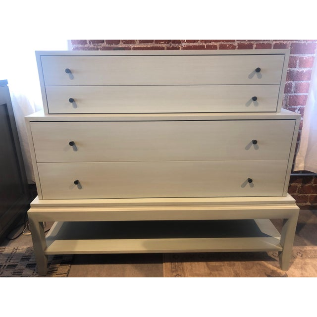 4 drawer chest finished in airy blue painted finish with antique bronze hardware. Additional shelf sits below the drawers...