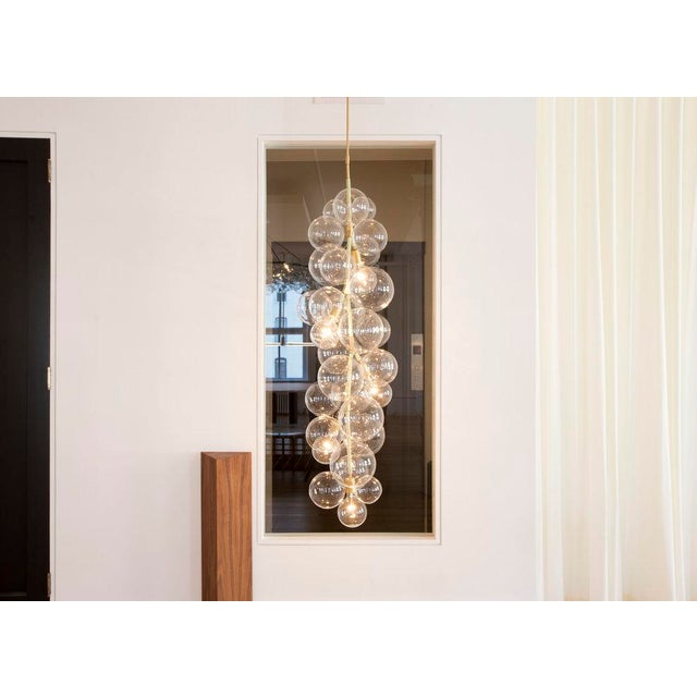 """By Pelle Starting Price: $13,600 in satin brass Specifications: 18"""" dia x 60"""" h (13 lbs) Shown In: Satin Brass w/ Natural..."""