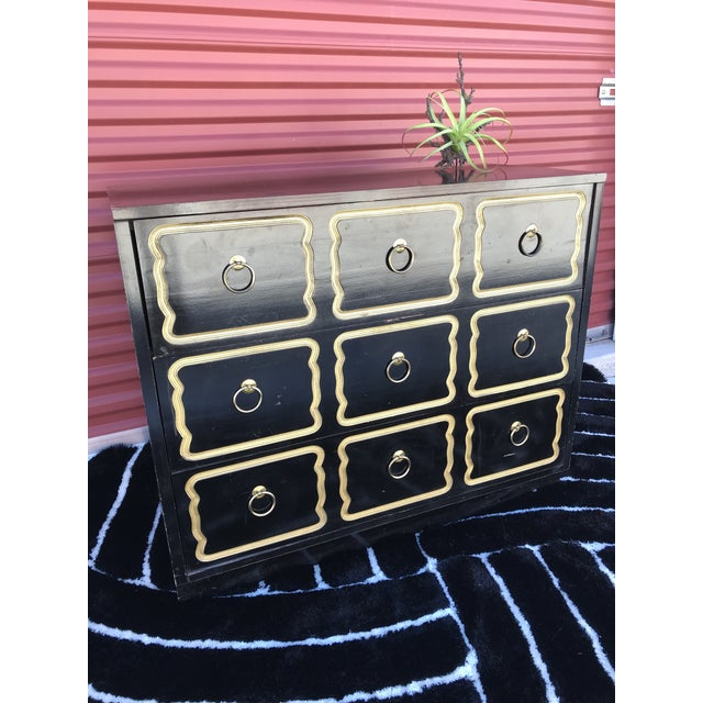 Dorothy draper Espana chest or commode. Three drawers original black paint , gold trim and original brass hardware. 1950s