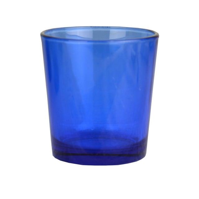 DOF/Cocktail drinking glasses in vibrant cobalt blue. No maker's mark.