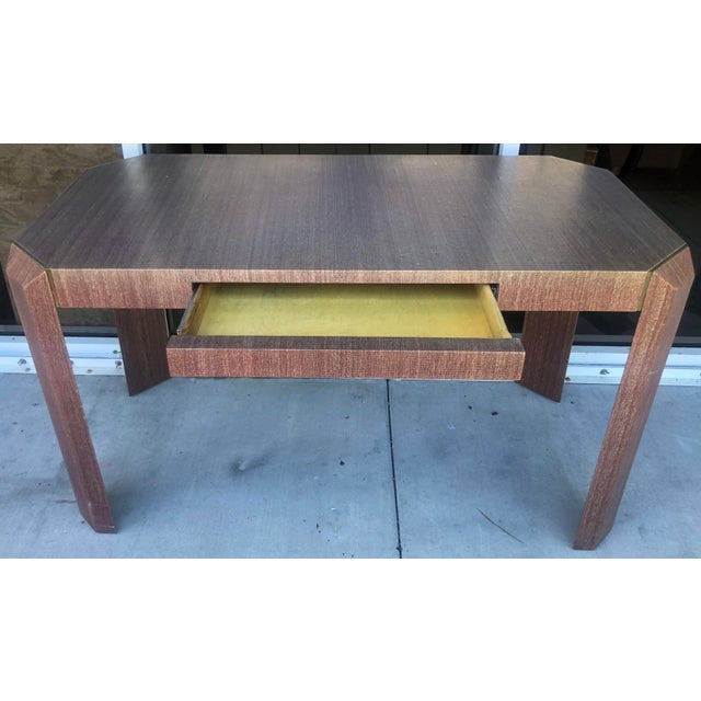 Cool and chic linen covered desk in the manner of Karl Springer. Solid brass accents. One central drawer. Some...