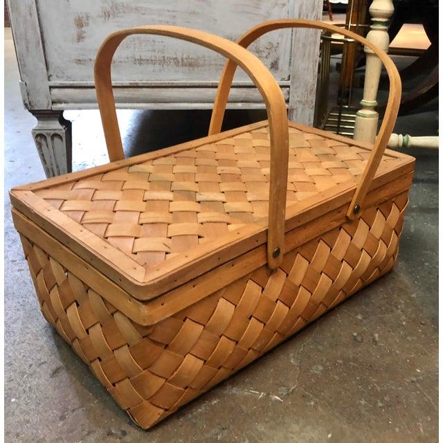 Vintage handmade in the USA 1930s aged wood veneer picnic basket with lid.