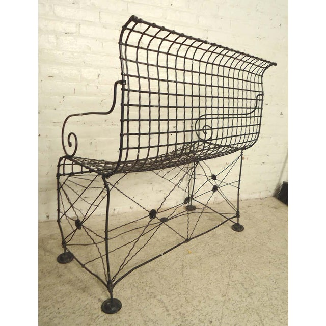 Attractive petite iron bench with scrolled arms and webbed base. Great as lawn furniture. :