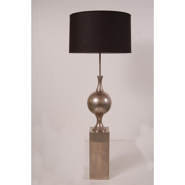 Floor lamp designed by Philippe Barbier, France, circa 1968. Lamp is constructed of nickel plated steel. Lamp has been...