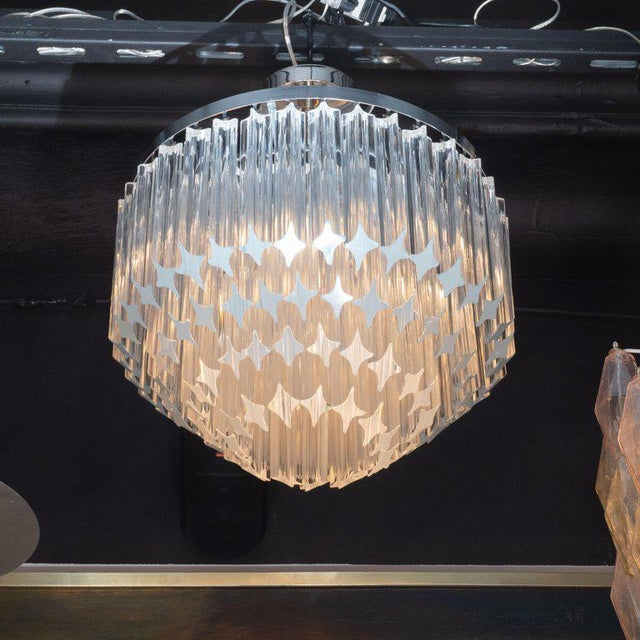 This refined chandelier was realized in Italy, circa 1970. It features an abundance of camer crystals hanging from...