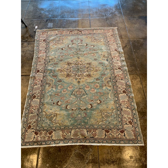 Highly versatile size antique Persian rug with dense hand done loom work and natural dyes create a captivating light blue...