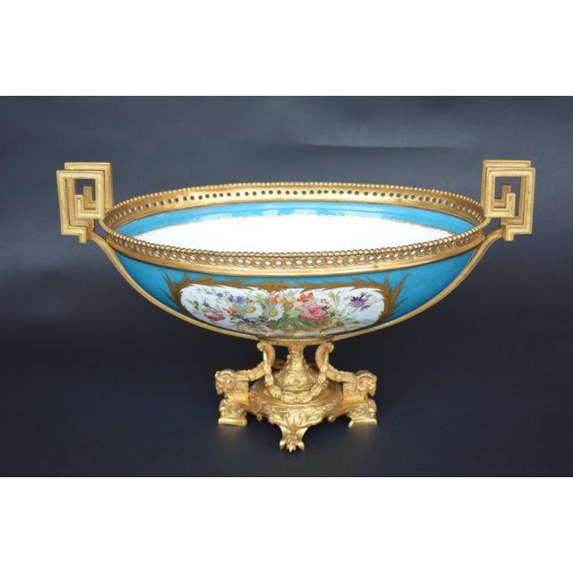 A sèvres style parcel-gilt ormolu-mounted enameled blue celeste porcelain center bowl, last quarter of the 19th century,...
