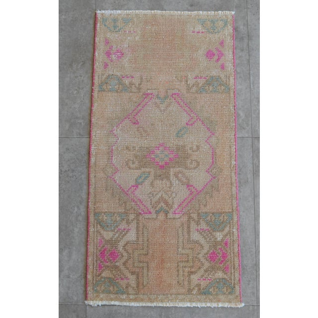 Vintage Turkish small rug perfect for a small guest bath, in front of the kitchen sink, entryway or laundry. background...