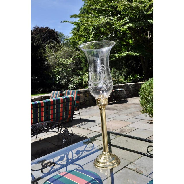19th Century acid-etched hurricane shade on a polished brass candle-holder. The antique brass base has been polished and...